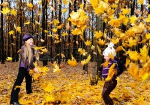 10563783-children-in-autumn-forest-play-fallen-down-leaf